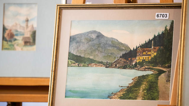 """A picture taken on February 8, 2019 shows the  watercolour entitled """"Ortschaft an Vorgebirgssee"""" a scene of a village near a mountain lake, signed """"A. Hitler"""", on display at the Weidler auction house in Nuremberg, Germany. (Photo: AFP)"""