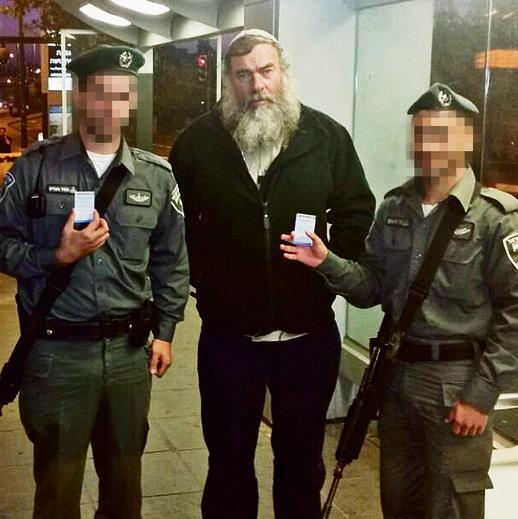 Honenu CEO Shmuel Meidad, center, handing out the NGO's calling cards to Border Policemen