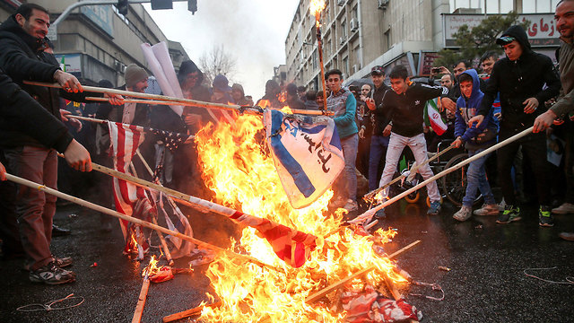 Burning Israeli and American flags in Tehran to mark the 40th anniversary of the revolution (Photo: Reuters)