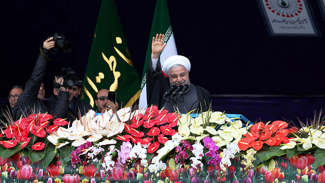 Hassan Rouhani gives speech at 40th anniversary  (Photo: Reuters)