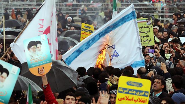 Israeli flag being burned during 40th anniversary (Photo: EPA)