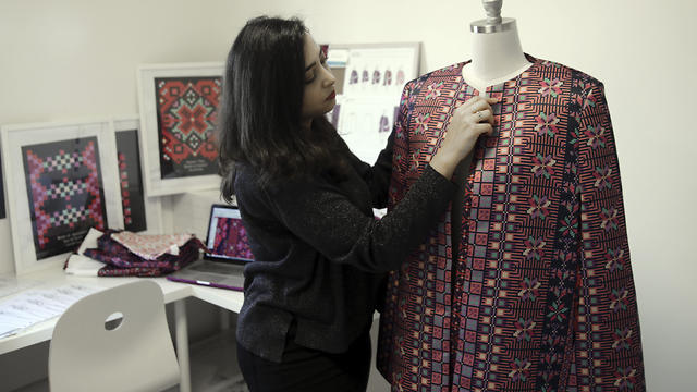 Designer Natalie Tahhan works on a modern version of the traditional Palestinian thobe in her studio in East Jerusalem