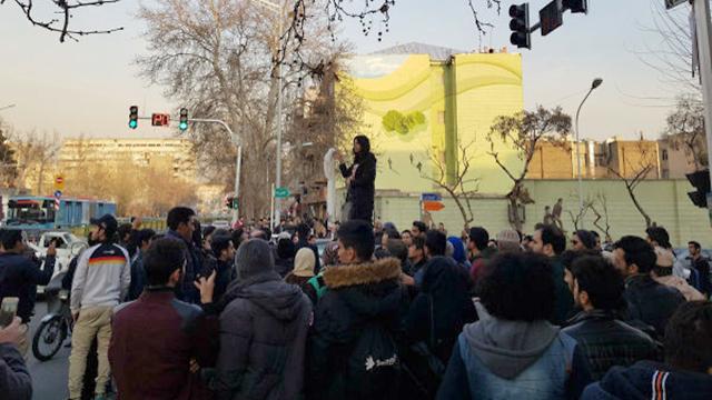 Azam removing her headscarf in Tehran