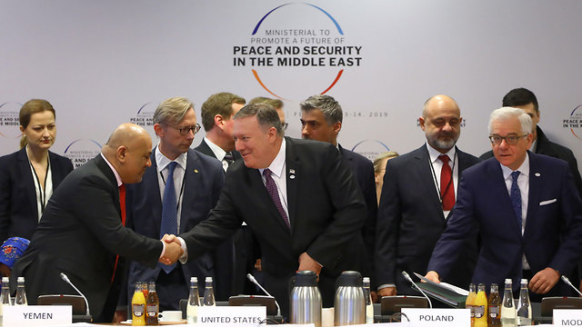 Mike Pompeo shaking hands with Arab diplomats