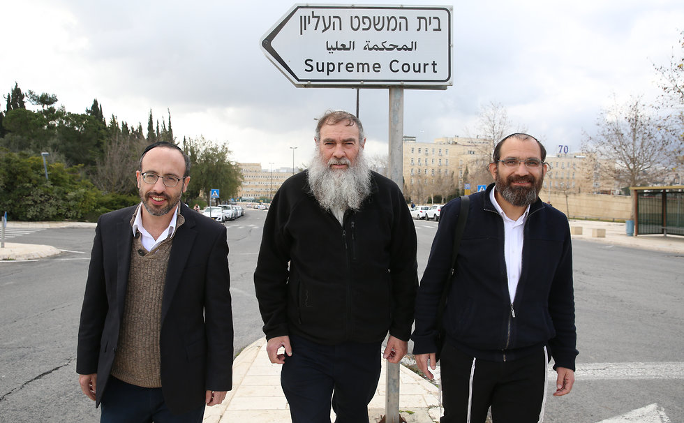 Honenu CEO Shmuel Meidad, center, with two other lawyers that work for the NGO (Photo: Amit Shabi)