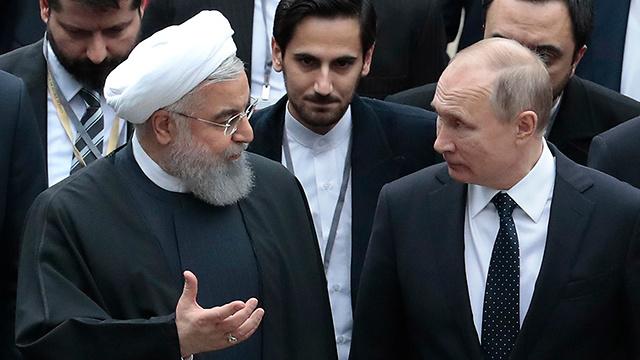 רג'פ טאיפ ארדואן ,ולדימיר פוטין וחסן רוחאני  בסוצ'י רוסיה (צילום: EPA)