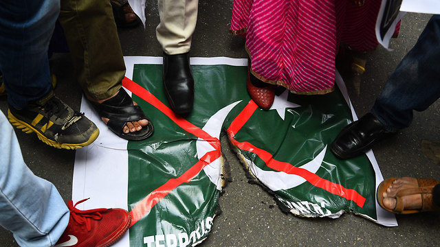 Indians trample the Pakistani flag over recent events  (Photo: AFP)