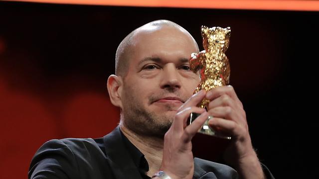 נדב לפיד זוכה בדב הזהב בפסטיבל ברלין  (צילום: AP)