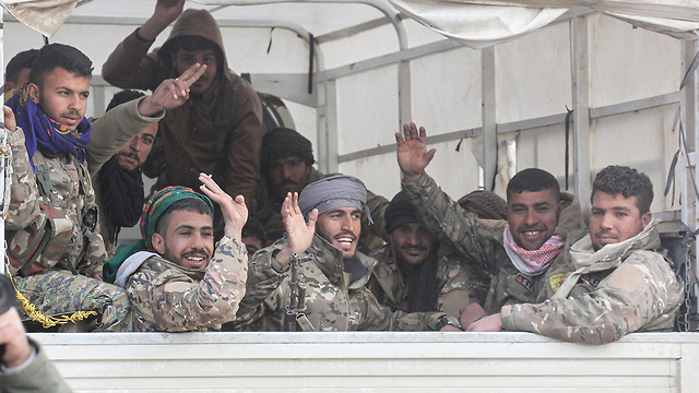 Kurish fighters in Syria celebrate victory over Islamic State (Photo: MCT)
