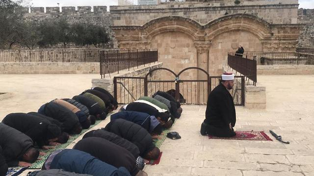 Muslim Prayers next to the shuttered compound on Temple Mount