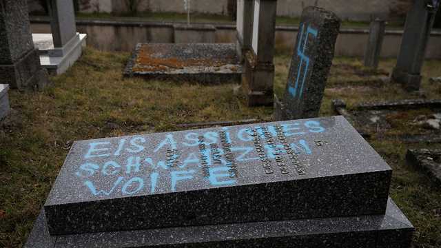 Graves desecrated with swastikas are seen in the Jewish cemetery in Quatzenheim, near Strasbourg, France, February 19, 2019 (Photo: Reuters)