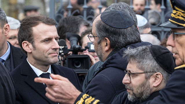 Emanuel Macron visits a desecrated Jewish cemetery in Alsace (Photo: AP)