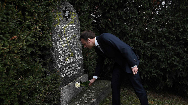 Emanuel Macron visits a desecrated Jewish cemetery in Alsace (Photo: AFP)