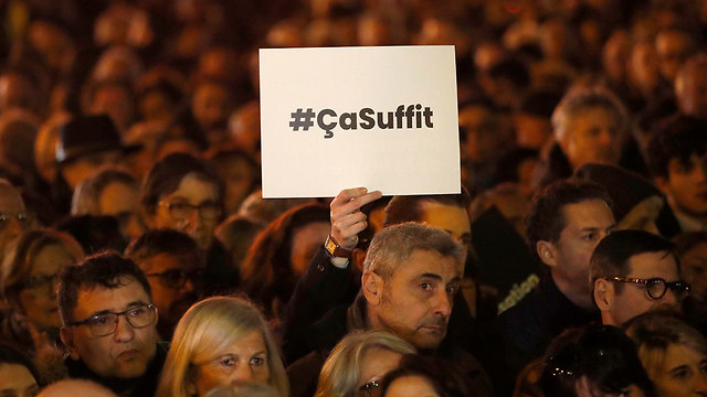 Protest against anti-Semitism in Paris. The poster reads: That's enough (Photo: AP)