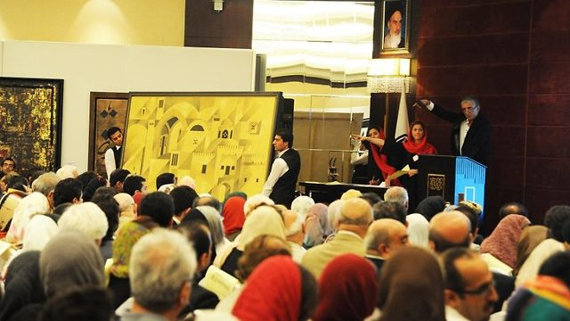 Iranians attend the first contemporary art auction in Tehran, June 2012  (Photo: Getty Images)