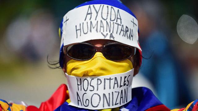 ונצואלה עימותים שיירת סיוע הפגנה בעד חואן גוואידו קראקס (צילום: AFP)