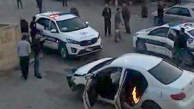 תיעוד לחילופי האש בין שוטרים וחשודים בטובא ()
