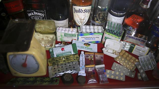 Confiscated drugs and alcohol are stored inside the anti-drug department at the main police headquarters in Gaza City