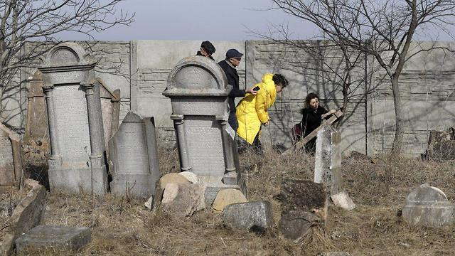 Preservation work at a Jewish cemetery in Slovakia (Photo: AP)