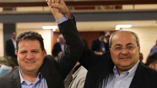 Hadash-Ta'al leaders Ayman Odeh (L) and Ahmad Tibi