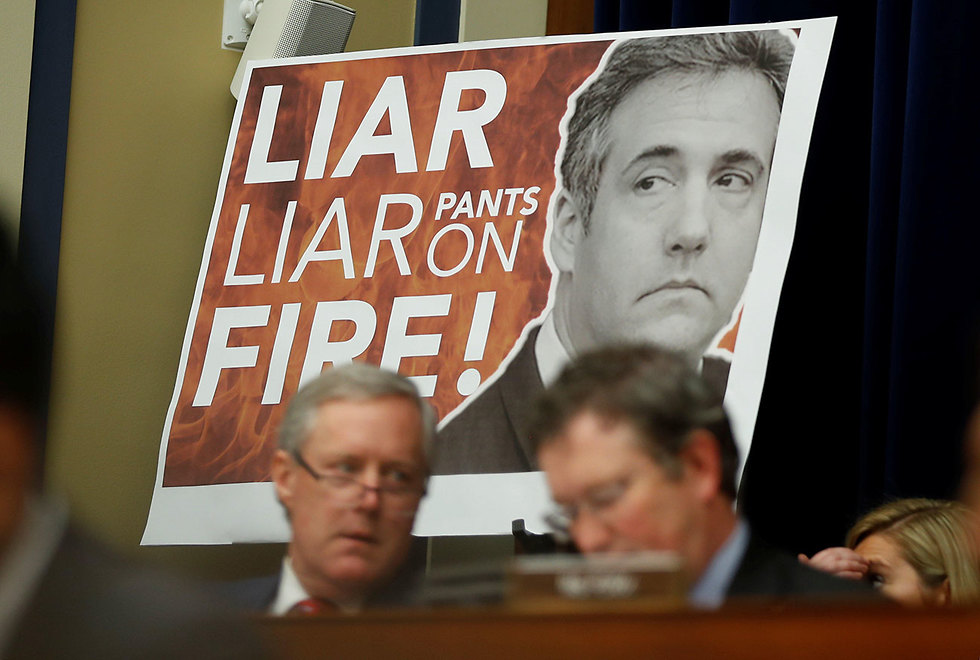 Poster calling Cohen a liar during his testimony against Trump in Washington in February (Photo: Reuters)