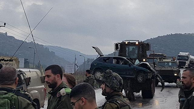 Vehicle used by the Palestinians in the attack is being evacuated