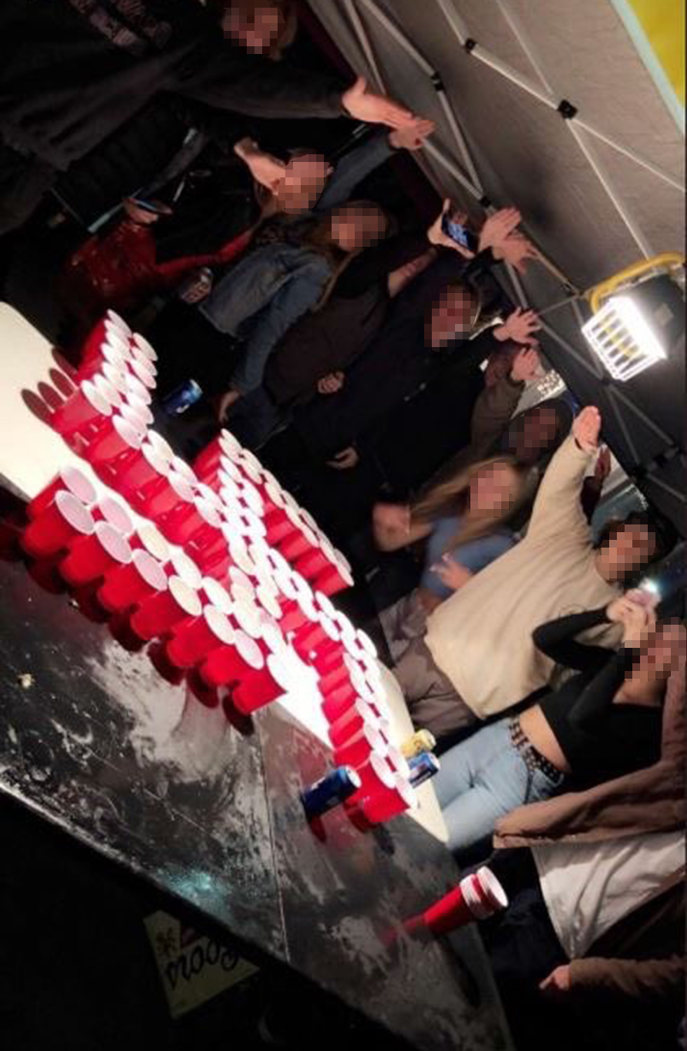Orange County students playing beer pong with cups set up in a swastika formation  (Photo: Instagram)