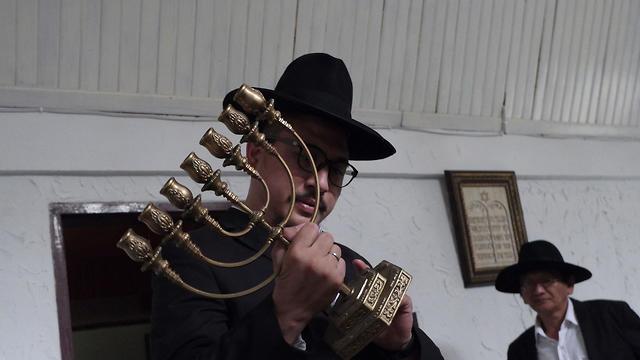 Rabbi Yaakov Baruch holding a menorah at a synagogue in Tondano, North Sulawesi, March 4, 2019