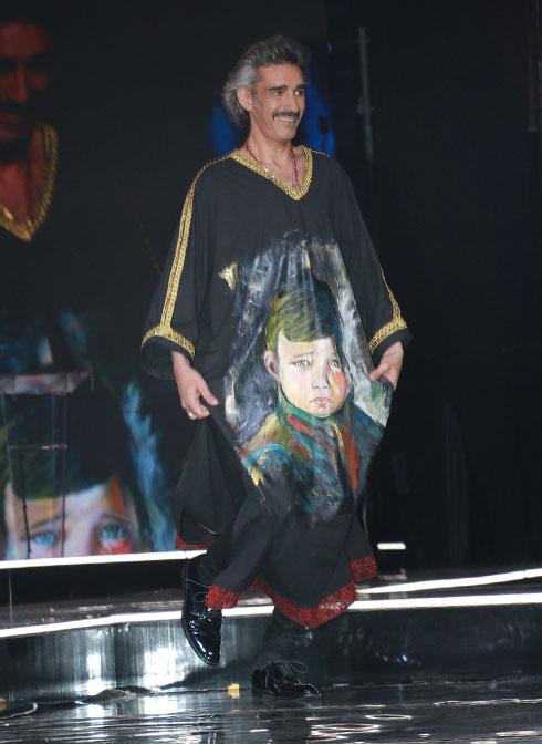 """גלבייה לגבר עם ציור של """"הילד הבוכה"""", בעיצוב מעוז דהאן (צילום: ענת מוסברג)"""