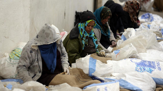 Palestinian women working at a peanut factory in Rafah in the southern Gaza Strip