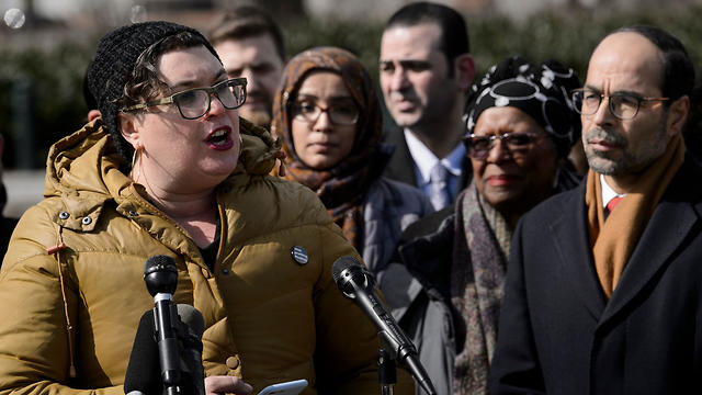 Council on American-Islamic Relations Executive Director Nihad Awad (R) and others listen while Jewish Voice for Peace Deputy Director Rabbi Alissa Wise speaks during a press conference to supportUS Representative Ilhan Omar