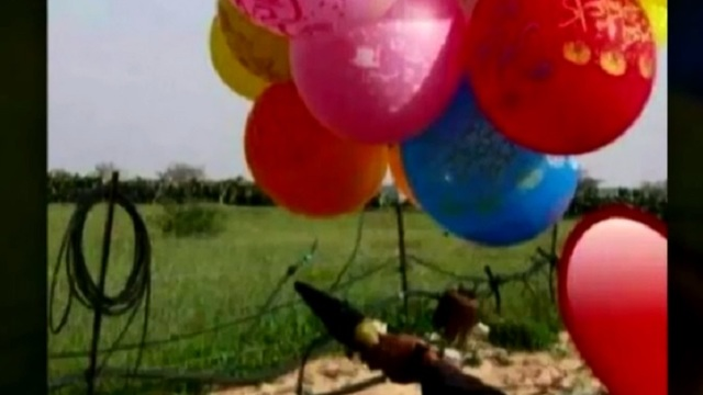 Balloons carrying the warhead of an anti-tank missile from Gaza to Israel