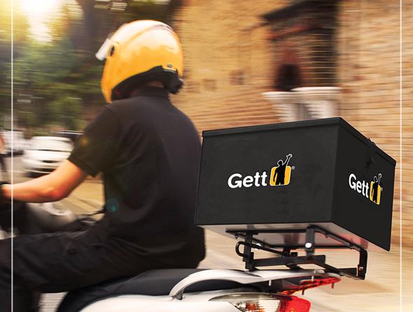 Курьер, работающий с аппликацией Gett Delivery. Фото: Gett