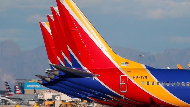 Southwest Airlines Boeing 737 MAX 8 aircraft sit on the tarmac at Phoenix Sky Harbor International Airport on March 13, 2019