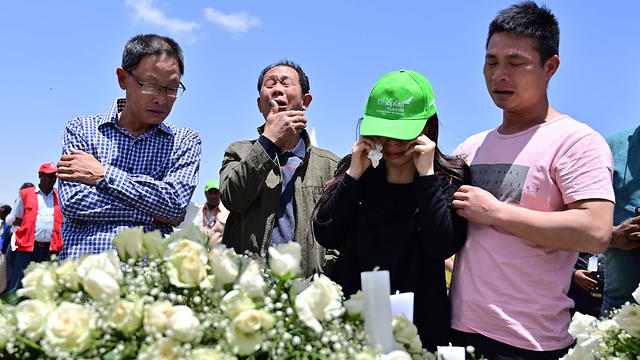 The families of the Ethiopia Airlines crash victims visit the site of the disaster near Addis Ababa