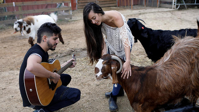 Volunteers offer a musical interlude for the residents of Freedom Farm