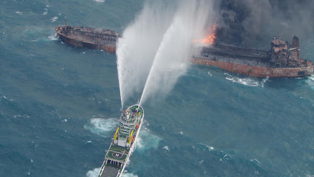 A rescue ship works to extinguish the fire on the stricken Iranian oil tanker Sanchi in the East China Sea, on January 10, 2018