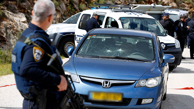 The car stolen and abandoned by the gunman (Photo: AFP)