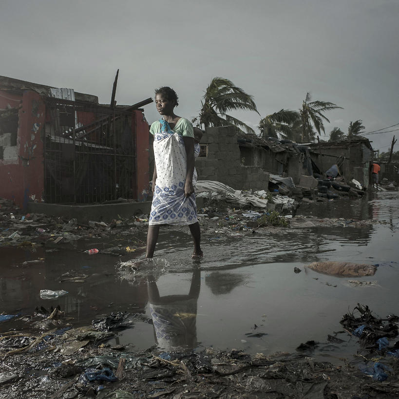 A handout photo made available by CARE, an international humanitarian agency shows a local resident walking among the ruins after cyclone Idai (Photo: EPA)