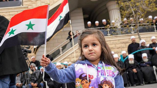 A child waves a Syrian flag in Israeli Druze town of Majdal Shams (Photo: Effi Sharir)