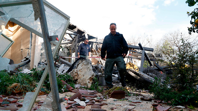 Site of rocket fire on home in central Israel (Photo: AFP)