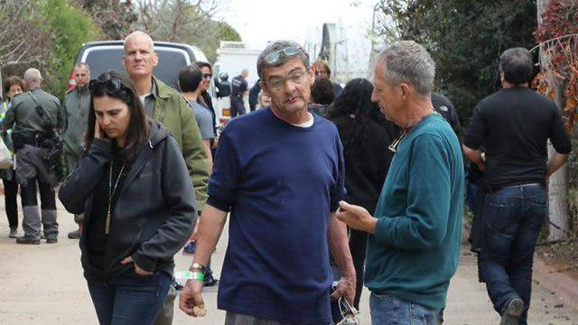 Robert Wolf, center, the owner of the home hit by a Gaza rocket surveys the damage, apparently after his release from hospital (Photo: Dana Kopel) (Photo: Dana Kopel)