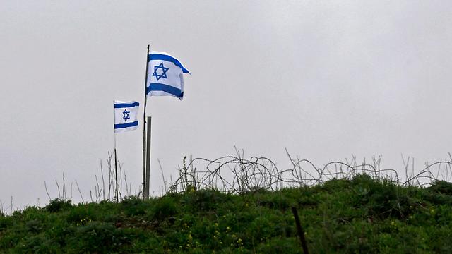 Israeli flags on Golan Heights (Photo: AFP)