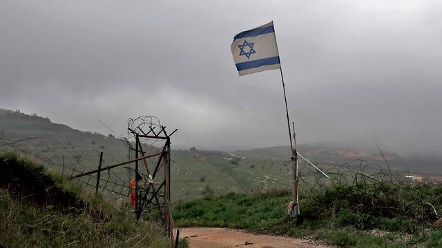 Израильский флаг над Голанами (Photo: AFP)