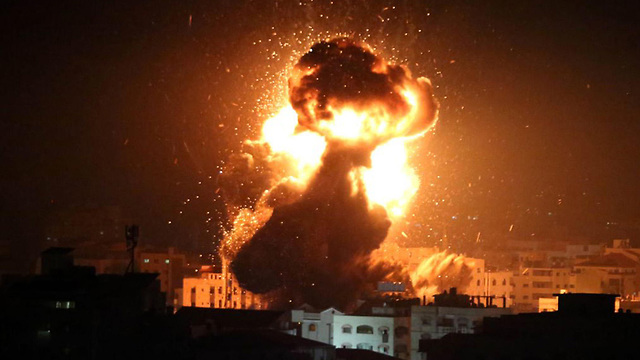 A fireball rises over Gaza City as the IAF bombs Ismail Haniyeh's office (Photo: MCT)