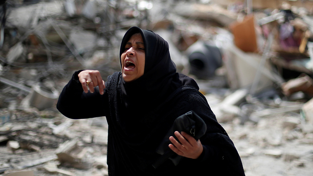 A Palestinian woman amid the rubble in the Gaza Strip after IAF strikes on Hamas targets (Photo: Reuters) (Photo: Reuters)