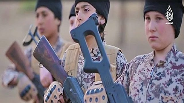 Screenshot of young boys training with weapons in an ISIS propaganda video