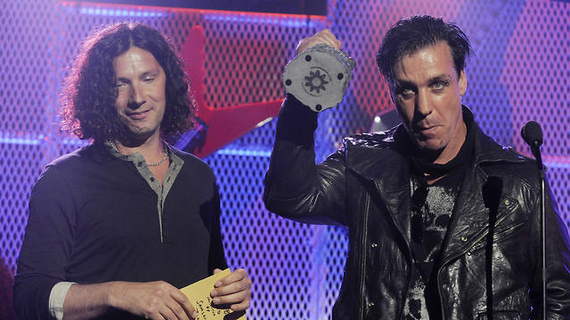 File photo:  German hard rock band Rammstein, with Till Lindemann, right, and Christoph Schneider accept the award for Best Live Band at the 3rd Annual Revolver Golden Gods Awards ceremony in Los Angeles, USA in 2011 (Photo: AP)