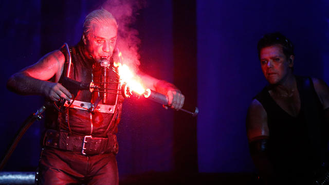 File photo: Rammstein performs with flares on stage during heavy metal Wacken Open Air (WOA) Festival 2013 in Wacken, northern Germany. (Photo: AFP)