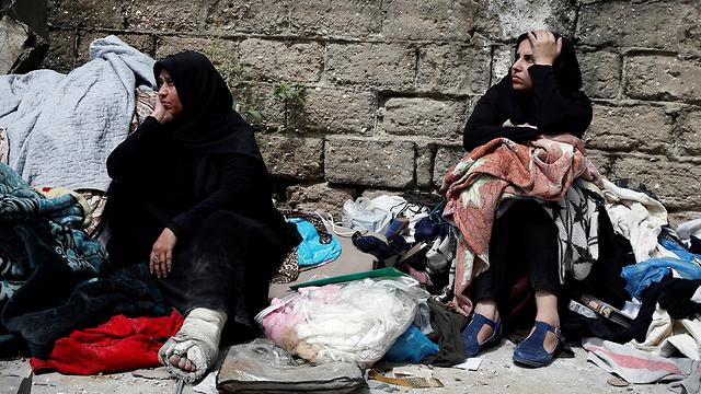 Gaza residents during Israeli air raid (Photo: Reuters)